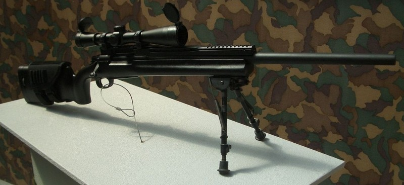 "T93 Sniper Rifle, © SP Lee, used with permission. http://commons.wikimedia.org/wiki/File:T93_sniper_rifle.jpg. This picture is not of a ""smart"" weapon, but you can imagine that it might be."