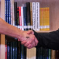"BALTIMORE - Lt. j.g. Max Murray, the Partnerships in Education coordinator at Coast Guard Sector Baltimore, shakes hands with Cameron Faulkner-Walker during a mock interview at the Maritime Industries Academy in Baltimore, Md., April 29, 2010. ""The sole purpose in doing this is to prepare high school students to integrate into a highly competitive job market or educational system,"" said Murray. ""In Baltimore we work with a diverse group that were are here to give them insight into the intricacies of finding a job verses finding a career."" U.S. Coast Guard photo by Petty Officer 3rd Class Robert Brazzell."