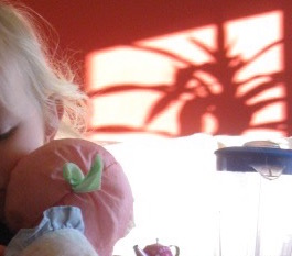 A monstery shadow looming over a small child.