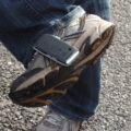 Foot kicking a cell phone.