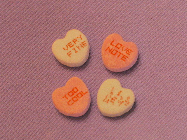 Conversation hearts showing one in alien language.