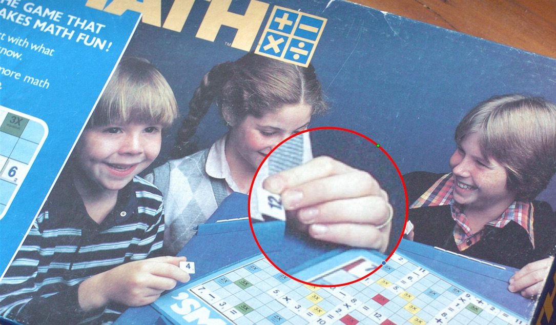 Board game cover showing young girl wearing wedding ring.