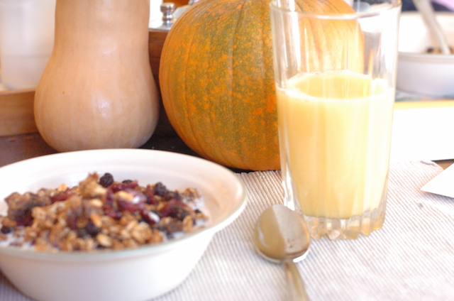 Granola, orange juice, and squash. Part of a complete breakfast.