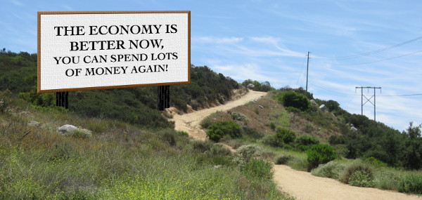 "A billboard reading ""The Economy is better now, you can spend lots of money again!"""