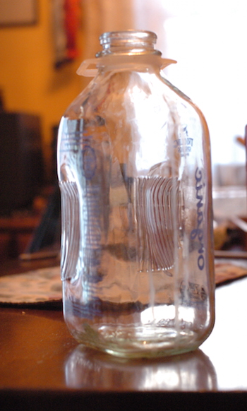 A glass milk jug.